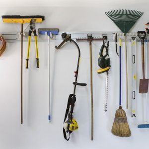 Lawn tools hanging in clean garage