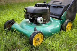 A modern lawn mower cutting through the grass