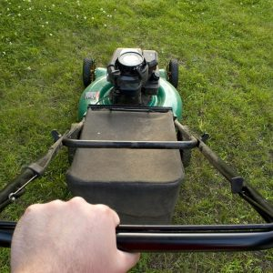 man pushing lawn mower